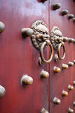 Red chinese door. Red traditional chinese door with metal knockers Stock Images