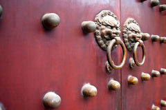 Red chinese door. Red traditional chinese door with metal knockers Royalty Free Stock Images