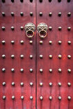 Red chinese door. Red traditional chinese door with metal knockers Royalty Free Stock Photos