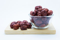 Red Chinese dry Jujube on wooden board Royalty Free Stock Photo