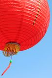 Red Chinese lantern. In the wind Royalty Free Stock Images