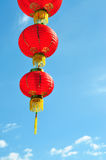 Red Chinese lantern against blue sky Stock Image