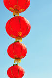 Red Chinese lantern against blue sky Royalty Free Stock Photo