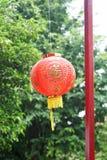 Red chinese lantern on green bokeh Royalty Free Stock Images