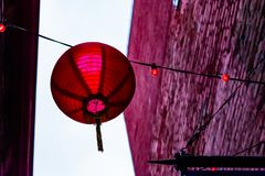 Red Chinese Lantern Hanging in Alleyway stock photography