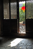 Red Chinese lantern outside doors Royalty Free Stock Photo