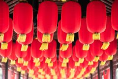 Red chinese lanterns hanging in a chinese bridge corridor. Close-up, Chengdu, China Stock Images