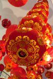 Red Chinese lanterns hanging from ceiling royalty free stock photos