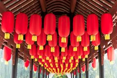 Red chinese lanterns hanging in a chinese bridge corridor Stock Images
