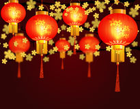 Red Chinese lanterns hung in the park. Round shape with patterns. Against the background of yellow cherry blossoms Royalty Free Stock Photography