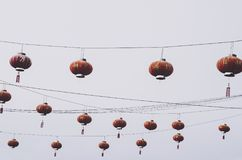 Red Chinese lanterns pattern hanging. High hanging red Chinese lanterns pattern; Mae Salong region in southern Thailand royalty free stock photo