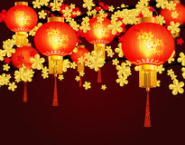 Red Chinese lanterns. Round shape with patterns. Against the background of the cherry blossoms. illustration Stock Images