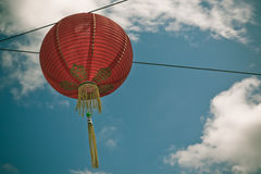 Red Chinese Paper Lantern against a Blue Sky Royalty Free Stock Image