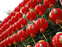 Red Chinese Paper Lanterns. A display of many rows of red Chinese paper lanterns hanging outdoors Stock Photo
