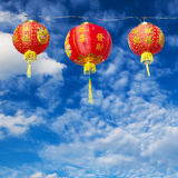 Red Chinese Paper Lanterns against Stock Photos