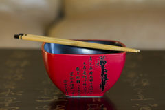 Red chinese rice bowl decorated with chinese calligraphy with ch Royalty Free Stock Images