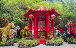 A red chinese style pavillion. Red chinese style pavillion with plants Royalty Free Stock Photography