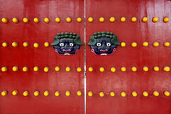 Red Chinese traditional wooden door monsters and nails Royalty Free Stock Images