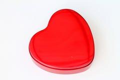 Red chocolate box shaped like a heart Stock Image