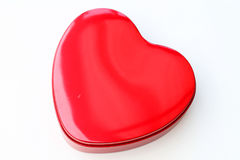 Red chocolate box shaped like a heart Stock Images