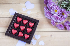 Free Red Chocolate Hearts In Box And Flowers On Wooden Table Stock Images - 63587824