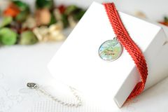 Red choker with a map pendant Royalty Free Stock Image