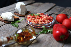 Red chopped paprika. With tomatoes and cheese, wooden background Stock Photography
