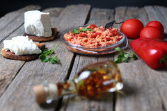 Red chopped paprika. With tomatoes and cheese, wooden background Royalty Free Stock Photos