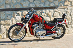 Red chopper against stone wall Stock Images