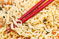 Red chopsticks on cooked instant ramen Stock Photography