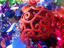 Red Chrismas ball on blue decoration Royalty Free Stock Images