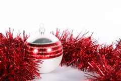 Red Christmas. A red glitter ball with decoration symbolizing Christmas. Isolated over white space (for text Royalty Free Stock Photos
