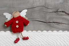 Red Christmas angel on grey wooden background Royalty Free Stock Photography