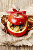 Red christmas apple stuffed with dried fruits in honey Royalty Free Stock Photography