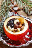 Red christmas apples stuffed with dried fruits Stock Image