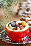 Red christmas apples stuffed with dried fruits Royalty Free Stock Photo
