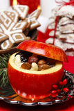 Red christmas apples stuffed with dried fruits in honey Royalty Free Stock Photos
