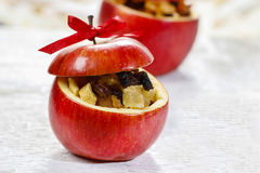 Red christmas apples stuffed with dried fruits in honey Royalty Free Stock Photography