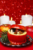 Red christmas apples stuffed with dried fruits Stock Photos