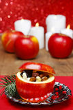 Red christmas apples stuffed with dried fruits in honey Stock Photo