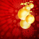 Red Christmas backdrop with gold balls. Stock Photos