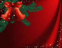 Red christmas background. With bells and furtrees branches Stock Images