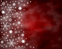 Red Christmas Background. An illustrated Christmas background with snowflakes on a red design Royalty Free Stock Image