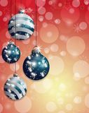 Red Christmas background bokeh with hung blue baubles. Vector Stock Image