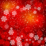 Red Christmas background. With bokeh and snowflakes Royalty Free Stock Image