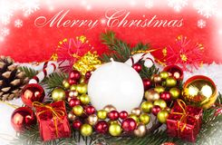 Red christmas background - card. White candle , red gifts, xmas balls in snow - with text Royalty Free Stock Photo
