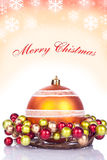 Red christmas background - card. Red christmas card - xmas ball and text Royalty Free Stock Images