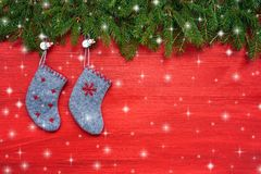 Red Christmas background. Christmas fir tree and Christmas socks on red wooden background. Copy space Royalty Free Stock Photography