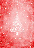 Red Christmas background with christmas tree. And snow, and swirls Royalty Free Stock Photography