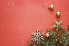 Red Christmas background with fir branches and golden decorations. Space for text. Top view Royalty Free Stock Photography